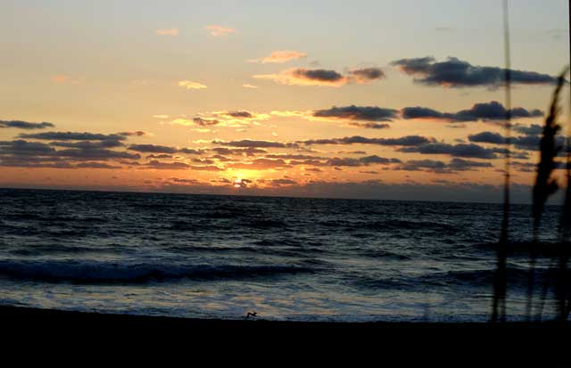 The sun rises over the Atlantic Ocean on the Outer Banks of North Carolina (Picture taken:  August 12, 2007)